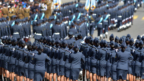 Sri Lankan military personnel march during the country's 66th Independence Day celebrations in the central town of Kegalle, about 40 kms from the capital Colombo.