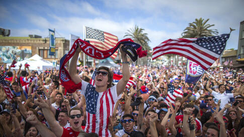 Fans cheerat a viewing party in Hermosa Beach, California, June 16, 2014, after the U.S. scored a second goal during the 2014 Brazil World Cup Group G soccer match between Ghana and the U.S.