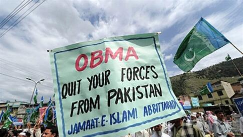 Activists of Pakistan's largest religious political party Jamaat-e-Islami (JI) march as they shout anti-US slogans during a protest rally against the US Special forces operation in Abbottabad on May 6, 2011. Hundreds of Pakistanis took to the streets on M