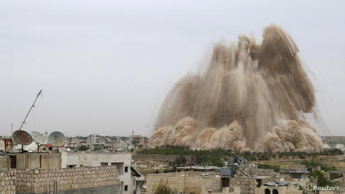 Debris rises in what the Free Syrian Army fighters and Islamic rebels said was an operation to strike the Al-Sahaba checkpoint, which is considered a gateway to Al-Dayf valley, and remove forces loyal to Syria's President Bashar Al-Assad in Maarat Al-N...