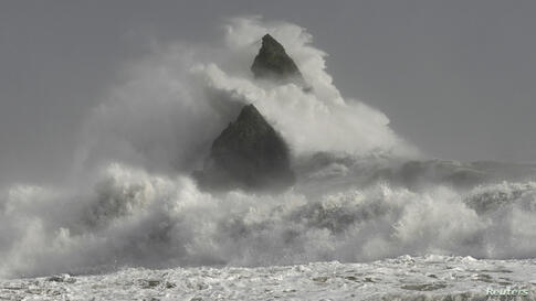 Large waves crash over Church Rock as hurricane force winds reach the coastline at Broad Haven, Pembrokeshire, Wales, Britain.