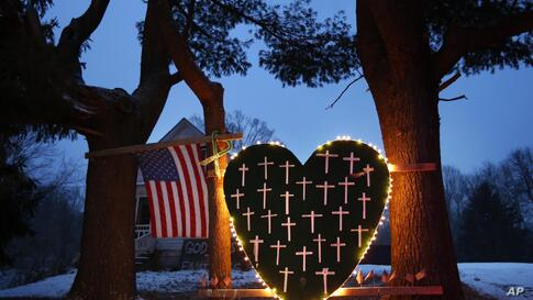 A makeshift memorial with crosses for the victims of the Sandy Hook massacre stands outside a home in Newtown, Connecticut, Dec. 14, 2013, on the one-year anniversary of the shootings.