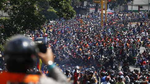 Thousands of motorcyclists drive during a protest against a measure to combat insecurity in Caracas, Venezula. Authorities imposed a night ban in a bid to curb crimes. Officials in Caracas and other areas made it illegal to ride a motorcycle after 9pm.