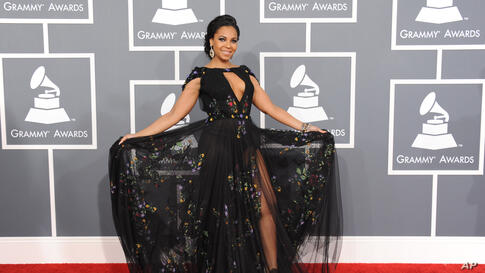 Ashanti arrives at the 55th annual Grammy Awards on Sunday, Feb. 10, 2013, in Los Angeles.