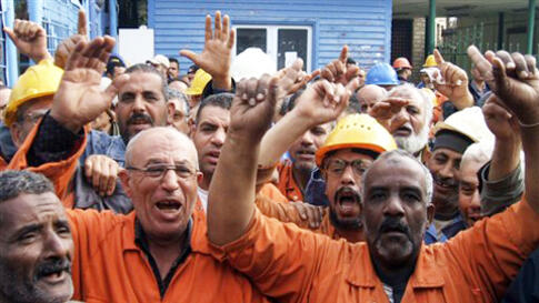 Suez Canal Company workers protest as they began an open-ended strike in front of the company's headquarters in Ismailia City, Egypt,Wednesday, Feb. 9, 2011.