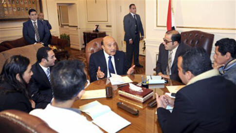 Egyptian Vice President Omar Suleiman, center, meets with representatives of protesters in Cairo, February 6, 2011