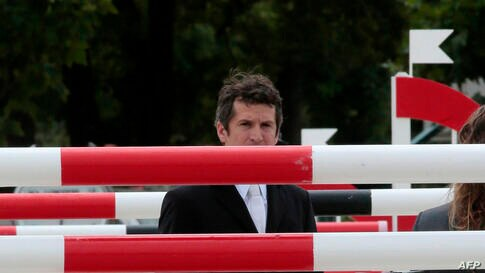 """French actor and director Guillaume Canet looks on before competing in the six bar contest of the """"Paris Eiffel Jumping"""" event at the Champs de Mars in Paris, near the Eiffel tower."""