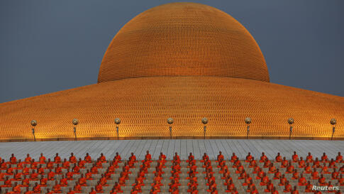 Buddhist monks pray at the Wat Phra Dhammakaya temple in Pathum Thani province, north of Bangkok on Makha Bucha Day. Makha Bucha Day honors Buddha and his teachings, and falls on the full moon day of the third lunar month.