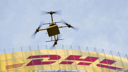 "A prototype ""parcelcopter"" of German postal and logistics group Deutsche Post DHL flies in front of the company's headquarters in Bonn. DHL showed its prototype ""parcelcopter,"" which is a modified microdrone that costs 40,000 euros ($54,900) and can ca..."