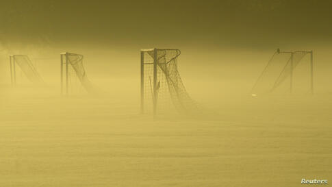 Soccer goal posts are seen in the autumn mist at Dukes Meadows in Chiswick, west London.