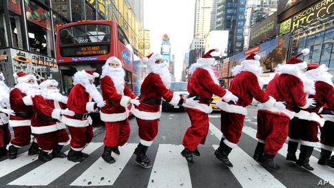 Santa Clauses bunny hop through Times Square as they deliver holiday PEEPS and spread cheer in New York, Dec. 4, 2013.