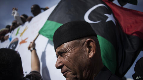 A Libyan man watches a protest against the Tripoli-based militias and supporting the new national army and the police corps in the Libyan capital.