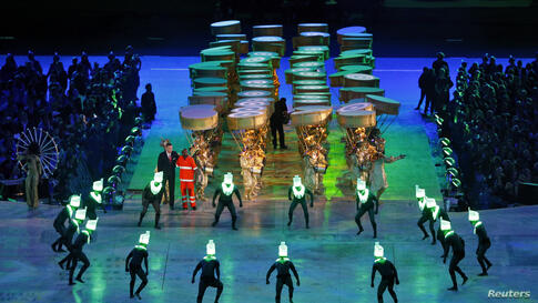 Performers take part in the closing ceremony of the London 2012 Olympic Games at the Olympic Stadium August 12, 2012.