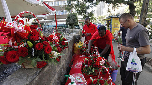 A customer buys red roses for celebrations of Valentine's Day at a flower market in Nairobi, Kenya, February 14, 2012 . (AP)