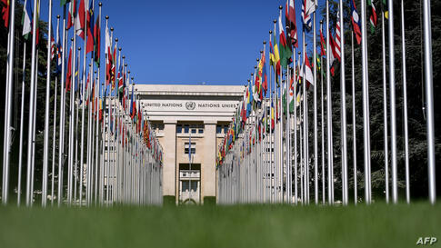 """The """"Palais des Nations"""", which houses the United Nations Offices, is seen at the end of the flag-lined front lawn on"""