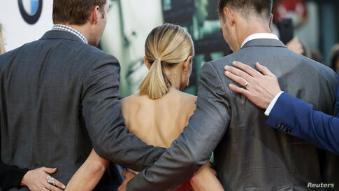 """Cast members Ryan Hansen (left), Kristena Bell (Center), and Jason Dohring (right) pose at the premiere of """"Veronica Mars"""" in Hollywood, California, Mar. 12, 2014."""