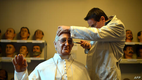 Fernando Canini, director of Rome's wax museum, gives the final touch at the new wax statue representing Pope Francis, Dec. 5, 2013. The statue will be shown to the public through Dec. 8, 2013.