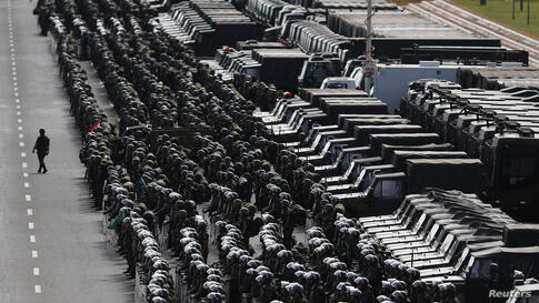 Members of the Brazilian Army, Navy and Air Force attend a presentation of Defense and Security personnel and equipment that will be used during the 2014 World Cup in Brasilia, June 8, 2014.