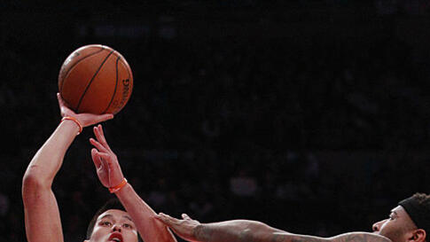 New York Knicks' Jeremy Lin shoots over Sacramento Kings' DeMarcus Cousins during an NBA basketball game February 15, 2012, in New York. (AP)