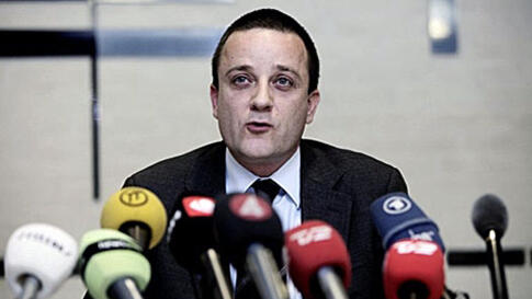 Head of the Danish Security and Intelligence Service Jakob Scharf talks to the media during a press conference in Copenhagen after Scandinavian intelligence agencies said they had foiled a plot Wednesday to kill staff at a Danish newspaper which published
