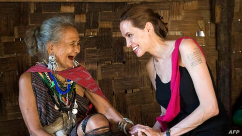 United Nations High Commissioner for Refugees (UNHCR) Special Envoy, Angelina Jolie (R), meets ethnic Karenni refugee Baw Meh, age 75, and her family from Myanmar, also known as Burma, at the Ban Mai Nai Soi refugee camp near the border with Thailand.
