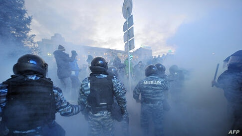 Police clash with protesters in Kiev, Ukraine.