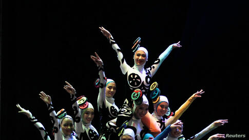 The China National Acrobatic Troupe performs at the Spring of Culture concert in Manama, Bahrain.