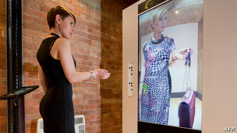 A woman tries out the Virtual Style Pod/Fashion 3D system at the FLux Innovation Lounge in east London. The technology uses body mapping software to superimpose items of clothing onto the customers body so that he or she can try on different styles wit...