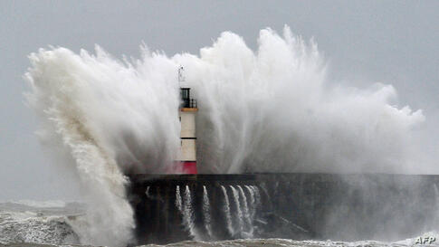 Newhaven Lighthouse is battered by waves during stormy weather on the southern coast of England. More than 8,000 homes were without power in southwest England after fresh storms battered the region, sending huge waves crashing onto the coastline and da...