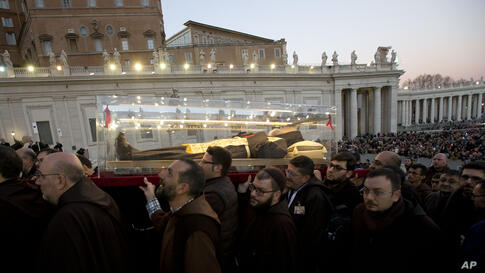 A box containing the corpse of Saint Pio da Pietralcina, who died in 1968, is carried in St. Peter's Square at the Vatican. Saint Pio, widely venerated in Italy and abroad, is famous for bearing the stigmata, which are the marks of Christ, and was cano...