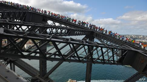 Rotary members and friends climb Sydney Harbour Bridge in an attempt to break the Guiness World Record for the most people on the bridge at one time and the most flags on the bridge at one time in Sydney, Australia. The number of people on the bridge, ...