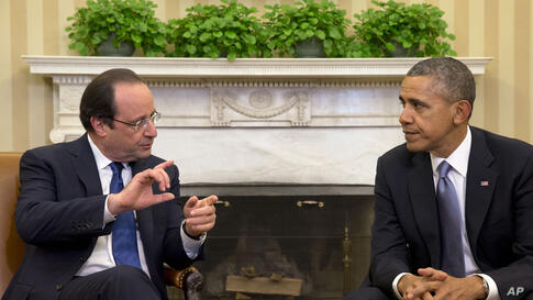French President Francois Hollande meets with President Barack Obama in the Oval Office of the White House, Feb. 11, 2014.
