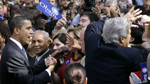 Barack Obama works the crowd during his first presidential campaign with John Kerry, during a rally at the College of Charleston campus in South Carolina, where Kerry endorsed Mr. Obama, January 10, 2008.