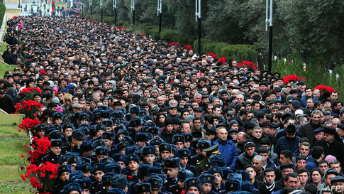 People visit Alley of Martyrs, a cemetery and memorial dedicated to those killed by Soviet troops during the 1990 Black January crackdown, in Baku, the capital of Azerbaijan.