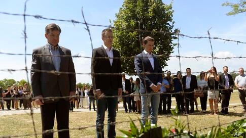 From left, Slovakian FMr Miroslav Lajcak, State Secretary of the Hungarian Ministry of Foreign Affairs and Trade Peter Szijjarto and Austrian FM Sebatian Kurz bow their heads at a monument, a remaining part of the former barbed wire fence, as they mark...