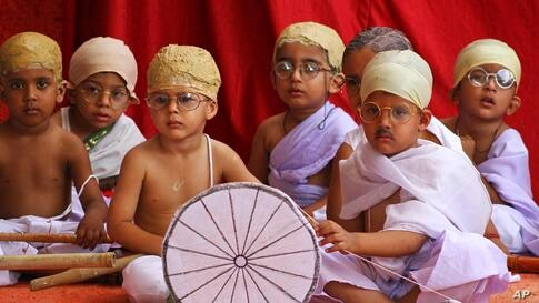 Indian children dressed like Mahatma Gandhi assemble at an event during Gandhi Jayanti in Ajmer. Gandhi Jayanti is the birth anniversary of Gandhi, the father of the nation.