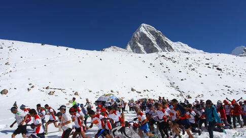In this photograph received by Himex, the organizers of the Tenzing-Hillary Everest Marathon, participants run at the start of the race at Gorapshep near Mount Everest Base camp in Nepal.