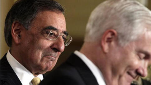 Defense Secretary nominee Leon Panetta, left, listens as outgoing Defense Secretary Robert Gates, speaks during a news conference in the East Room of the White House, Thursday, April 28, 2011, in Washington. (AP Photo/Carolyn Kaster)