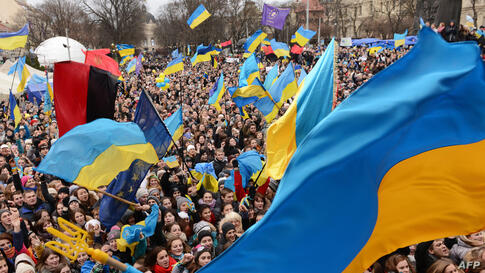 Pro-European protesters wave Ukrainian flags during a rally in the western Ukrainian city of Lviv. An EU summit to cap years of effort to bring ex-Soviet states into the Western fold opens with its ambitions dented after Ukraine, the biggest prize, bal...