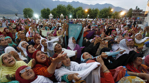 "Kashmiri Muslim women offer prayers following celebrations for ""Meeraj-un-Nabi"" at the Hazratbal shrine in Srinagar. Thousands thronged to the shrine, which houses a relic believed to be a hair from the beard of Prophet Mohammed, to celebrate concludin..."