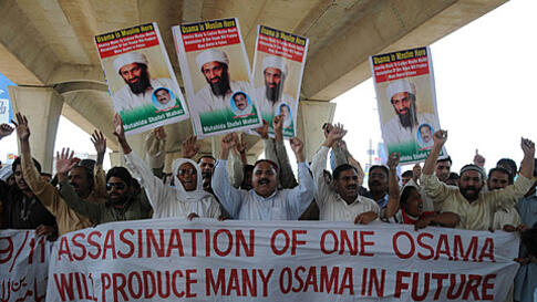 Supporters of a local social group Muthahida Shehri Mahaz rally to condemn the killing of al-Qaida leader Osama bin Laden in Multan, Pakistan on Friday, May 6, 2011. Osama bin Laden was killed by a helicopter-borne U.S. military force on Monday, in a fort