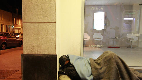 Joseph, a 51-year-old homeless man, sleeps outside a bank in Cambrai as freezing winter temperatures hit the country, February 2, 2012. (Reuters)