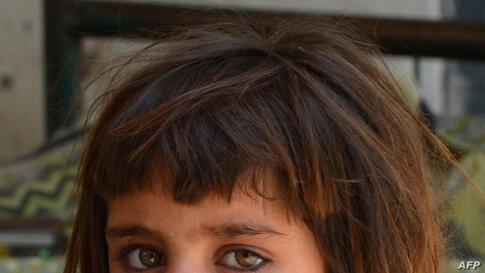 An internally displaced girl from North Waziristan looks on while taking shelter with her family at a school in Bannu, Pakistan.