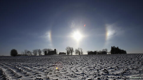 """A """"sun dog"""" atmospheric phenomenon appears over a farm in southern Minnesota. Chicago, Minneapolis and other parts of the upper Midwest will have two consecutive days of subzero highs on Monday and Tuesday, according to forecasters."""