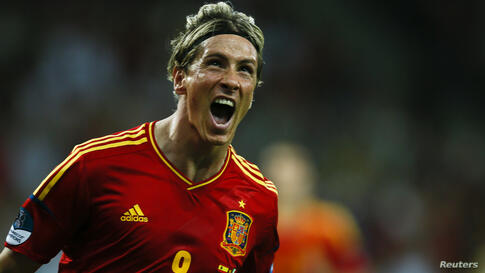 Spain's Fernando Torres celebrates after scoring a goal against Italy during their Euro 2012 final soccer match at the Olympic Stadium in Kiev, July 1, 2012.
