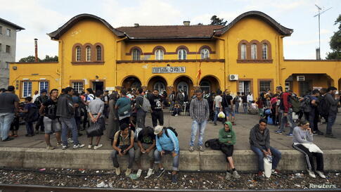 A group of immigrants arrive at the Gevgelija railway station Aug. 21, 2015.