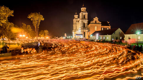 Belarus' Catholics attend the annual celebration of Icon of the Mother of God in Budslav, some 150 km north of Minsk, July 5, 2014.