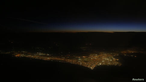 Kuwait City is seen after sunset from the aircraft of U.S. Secretary of State John Kerry as he flies from the Iran nuclear talks in Geneva, Switzerland to Abu Dhabi, UAE.