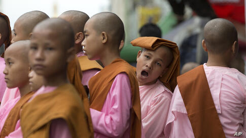 Novice Buddhist nuns line up after walking the streets to collect alms in central Yangon. Myanmar was trapped in a post-election limbo Tuesday with official results barely trickling in, although opposition leader Aung San Suu Kyi's party claimed a mass...