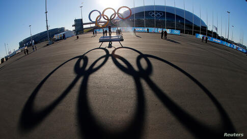 The Olympic rings are cast in shadow as the sun sets behind the Bolshoy Ice Palace as preparations continue at Olympic Park for the 2014 Winter Olympics in Sochi, Russia.